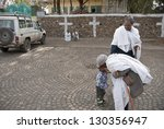 Small photo of GONDER, ETHIOPIA - MARCH 25: Unidentified Ethiopian elderly pilgrim bless boy in front of Tekla Haimonot's Orthodox Church during annual Abye Tsome (Great Fast) in Gonder on March 25, 2012, Ethiopia.