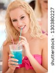 attractive blonde girl drinks... | Shutterstock . vector #130380227