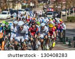 SAINT-PIERRE-LES-NEMOURS,FRANCE,MARCH 4: Image of the peloton riding during the first stage of the famous road bicycle race Paris-Nice, on March 4, 2013 in Saint-Pierre-les-Nemours. - stock photo