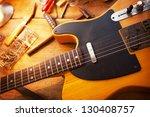 guitar on guitar repair desk.... | Shutterstock . vector #130408757