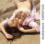 fashion portrait. sexy girl lying at beach - stock photo