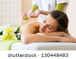 Beautiful woman having a wellness back massage and feeling visibly good about it - stock photo