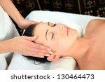 young woman receiving massage   ... | Shutterstock . vector #130464473
