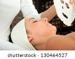 young woman receiving mask   spa | Shutterstock . vector #130464527