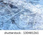 Close-up of cracked ice texture on river in spring time - stock photo