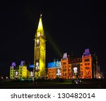 OTTAWA, CANADA -?? AUGUST 22:  The beautiful light show projected on the parliament building to celebrate the Canada'??s history and people in the summer night of August 22, 2011 in Ottawa, Canada. - stock photo