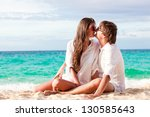 young happy couple kissing on... | Shutterstock . vector #130585643