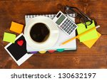 cup of coffee on worktable... | Shutterstock . vector #130632197