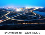 freeway in night with cars...   Shutterstock . vector #130648277