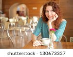 pretty young redhead woman with ... | Shutterstock . vector #130673327