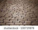 cobblestone pavement on a square in the evening - stock photo