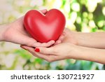 red heart in woman and man... | Shutterstock . vector #130721927