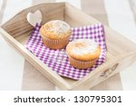 two tasty muffins muffins at a wood tray - stock photo