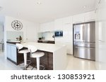 Modern kitchen in luxury house - stock photo