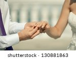 close up on hand of a groom put ... | Shutterstock . vector #130881863