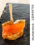 Smoked salmon snack. - stock photo
