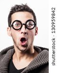 Portrait of a surprised geek with funny glasses. - stock photo