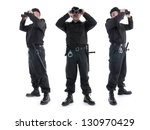 Three security guards wearing black uniform looking through binoculars, in three different directions, shot on white - stock photo
