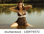 Young and beautiful sexy girl in the river. - stock photo