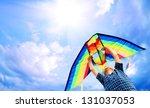 Happy Little Boy Flies A Kite...