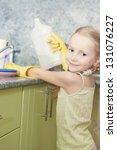 little blond girl makes dishes... | Shutterstock . vector #131076227