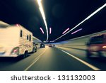 Vehicle traveling in the tunnel - stock photo