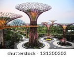SINGAPORE - MARCH 05: Gardens by the Bay at dusk on March 05, 2013 in Singapore. Gardens by the Bay was crowned World Building of the Year at the World Architecture Festival 2012 - stock photo