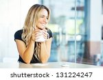 woman drinking coffee in the... | Shutterstock . vector #131224247