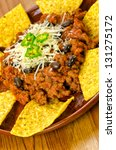 Mexican food: chili with meat and nachos - stock photo