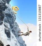 businesswoman climbing mountain ... | Shutterstock . vector #131310887