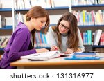 people studying together in a... | Shutterstock . vector #131316977