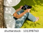 young woman in hat sitting on... | Shutterstock . vector #131398763