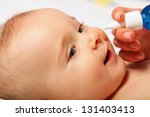baby on the bed   childhood | Shutterstock . vector #131403413