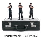 Three security guys standing on black cipher suitcase shot on white, security concept - stock photo
