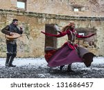 RODEMACK,FRANCE-DEC 09:Unidentified couple disguised as cave-people performing for entertaining the spectators  during a historical reenactment festival on December 9,2012 in Rodemack in France - stock photo