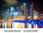 Night lights of Singapore with reflection in the river - stock photo