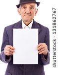 Elderly serious  man holding an empty white sheet of paper, isolated on white background - stock photo