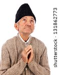 Romanian old peasant  praying, isolated on white background - stock photo