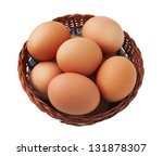 Easter egg in basket isolated on white background - stock photo