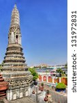 Wat Arun temple in Bangkok along the riverside - stock photo