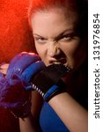 portrait of a aggressive woman boxer - stock photo