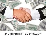 business handshake with  money... | Shutterstock . vector #131981297