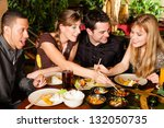 Young people eating in a Thai restaurant, they eating with chopsticks - stock photo
