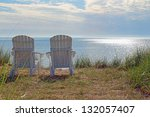Adirondack Chairs On The Shore...