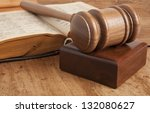 Wooden gavel and vintage old book - stock photo