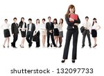 Confident business woman with her team on white background. - stock photo