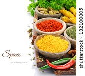 Colorful mix of spices isolated over white - stock photo