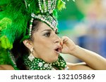 RIO DE JANEIRO - FEBRUARY 10: A woman in costume dancing and singing on carnival at Sambodromo in Rio de Janeiro February 10, 2013, Brazil. The Rio Carnival is biggest carnival in world. - stock photo