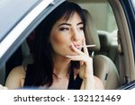 woman in the car - stock photo