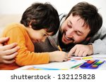 Father and little boy of fivr years having fun painting at home - stock photo
